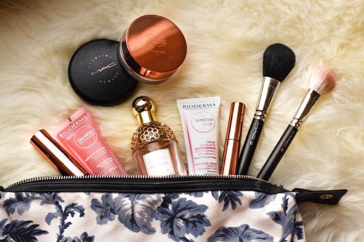 Make up bag with brushes, powder and perfume