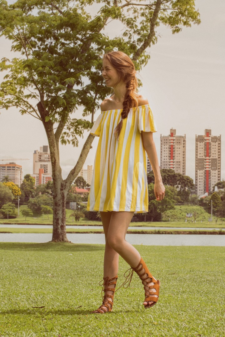 Striped summer dress at barigui park with buildings
