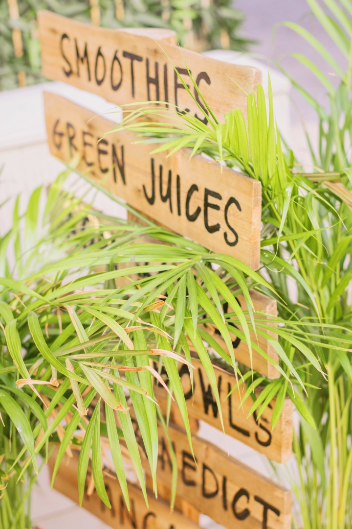 wooden signs with plants at Nicolau cafe in Lisbon / Portugal