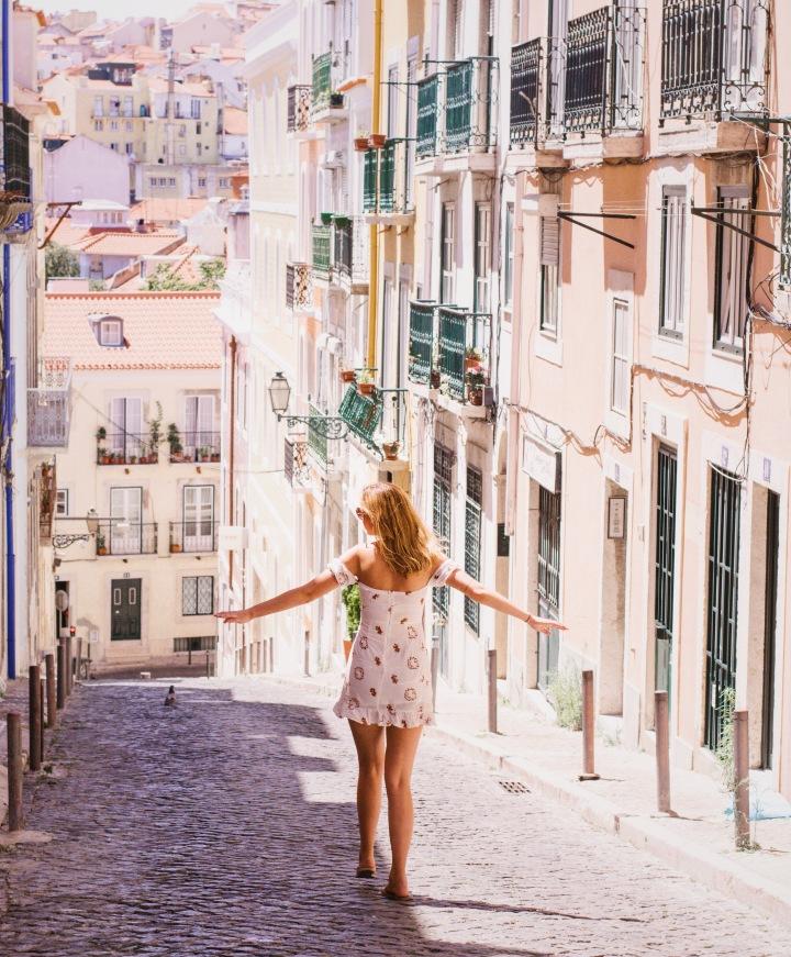 Girl walking through Lisbon / Portugal